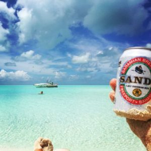 Sipping ice-cold beer on the beach in the Bahamas