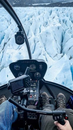 Taking a scenic helicopter trip over the glaciers in Alaska
