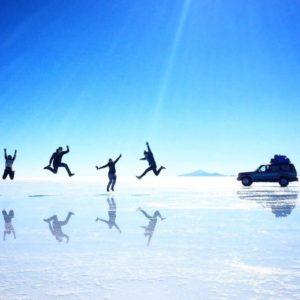 Reflecting joy at Salar de Uyuni, Bolivia
